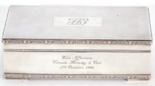 Hallmarked silver table cigarette box of rectangular form, engine turned lid to a single division