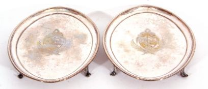 pair of antique silver-plated teapot stands of oval form, beaded borders,