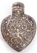 Large William Comyns silver heart shaped perfume flask, London 1898, typically decorated with