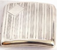 George V silver cigarette case of shaped square form, with engine turned decoration back and