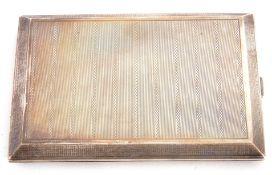 George V silver cigarette case of rectangular form, engine turned decoration, side full length