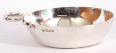 Elizabeth II solid silver wine taster, the round bowl applied with a coiled snake loop handle, 9cm