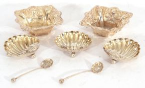 Mixed Lot: three late Victorian shell shaped salts, gilt lined, standing on three ball feet, Chester