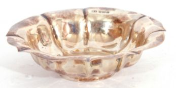 George V silver small shallow bowl of circular form with wavy rim and a fluted design, Sheffield