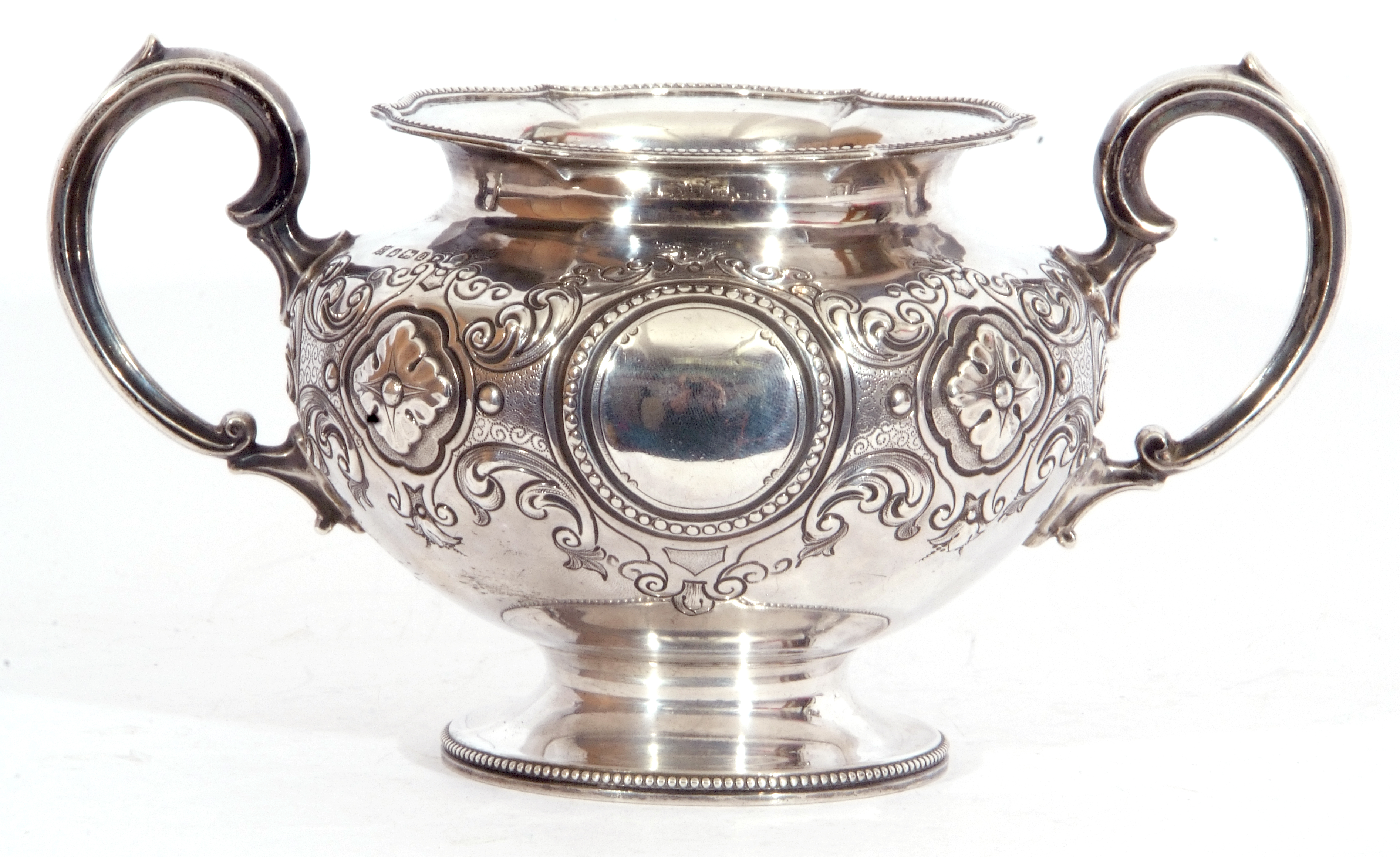 Victorian twin handled sucrier of squat circular form, with two scroll capped handles, beaded