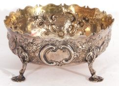 Victorian silver sugar bowl, circular form, of George II design, embossed and chased with flowers