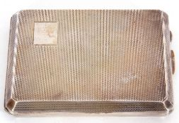 George VI silver cigarette case of rectangular form with a plain corner set cartouche, engine turned