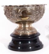 Late Victorian silver rose bowl raised on a pedestal foot and having an all over chased leaf and