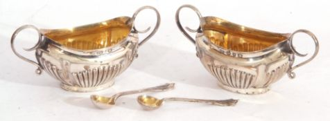Cased pair of late Victorian silver open salts and matching spoons, boat shaped with fluted bodies