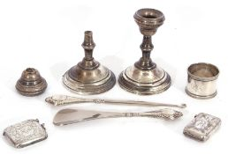 Mixed Lot: Edwardian silver vesta, a white metal vesta stamped 800, a pair of dwarf candlesticks (