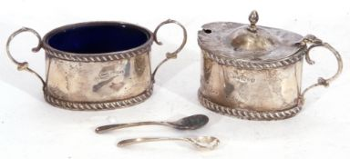 George V silver mustard of oval form with domed hinged lid and urn finial, gadrooned borders,