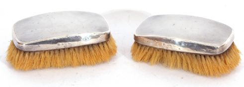 Pair of George VI silver backed clothes brushes with engine turned decoration, Birmingham 1938,