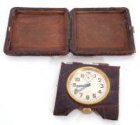 Art Deco crocodile skin cased folding travel clock with an 8-day movement, luminous numbers and