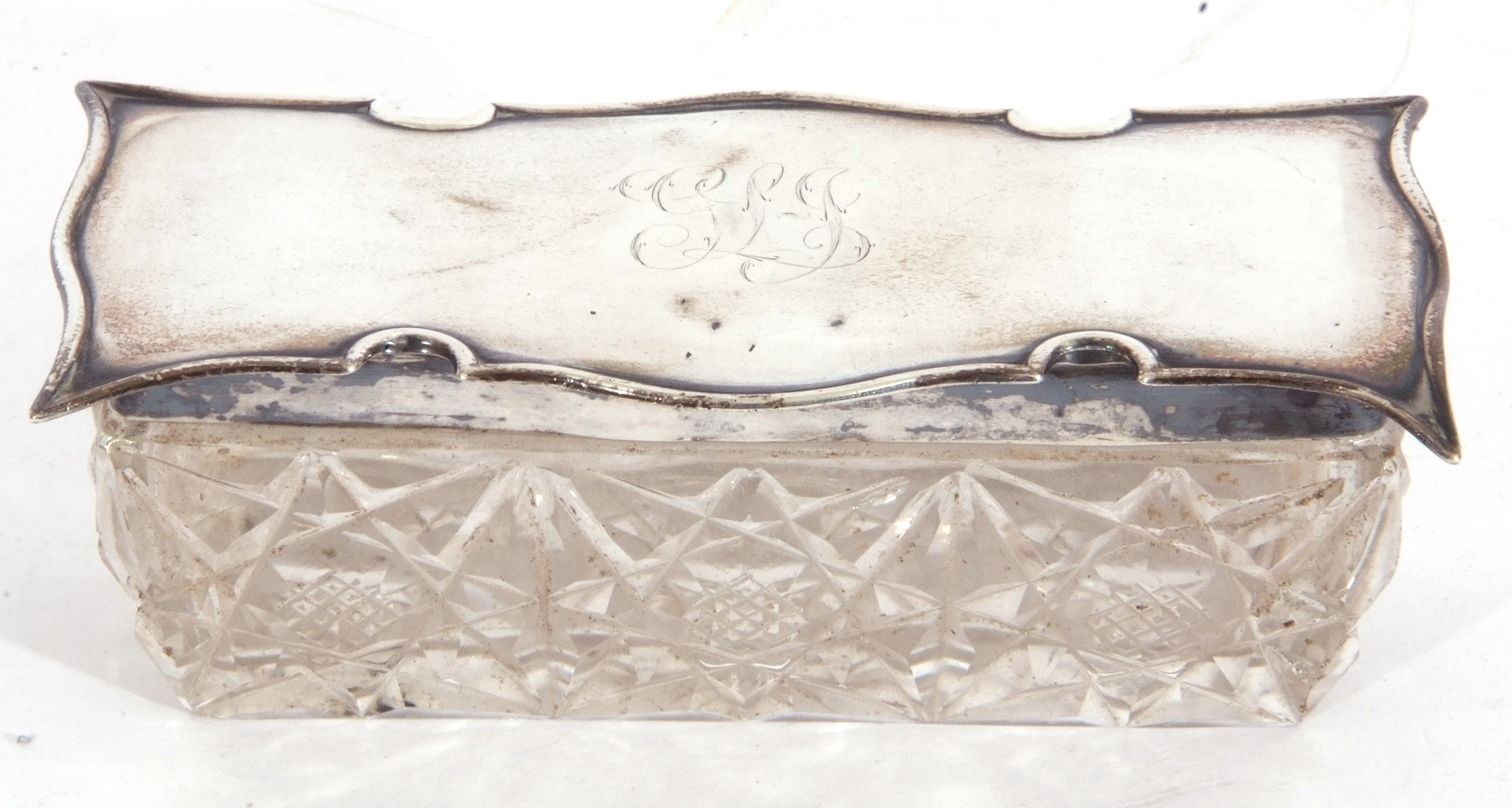 Edward VII silver lidded and glass trinket box of rectangular form, the cut glass base with shaped