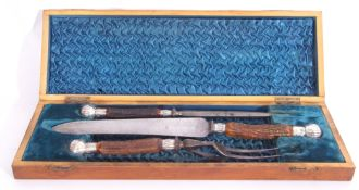 Cast Victorian three piece cased carving set with stag antler handles, silver mounts marked to