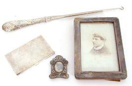 Mixed Lot: large Victorian handled button hook, London 1888, a silver photograph frame, Birmingham