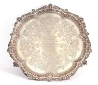 Victorian silver salver of shaped circular form with shell and bead border, central presentation