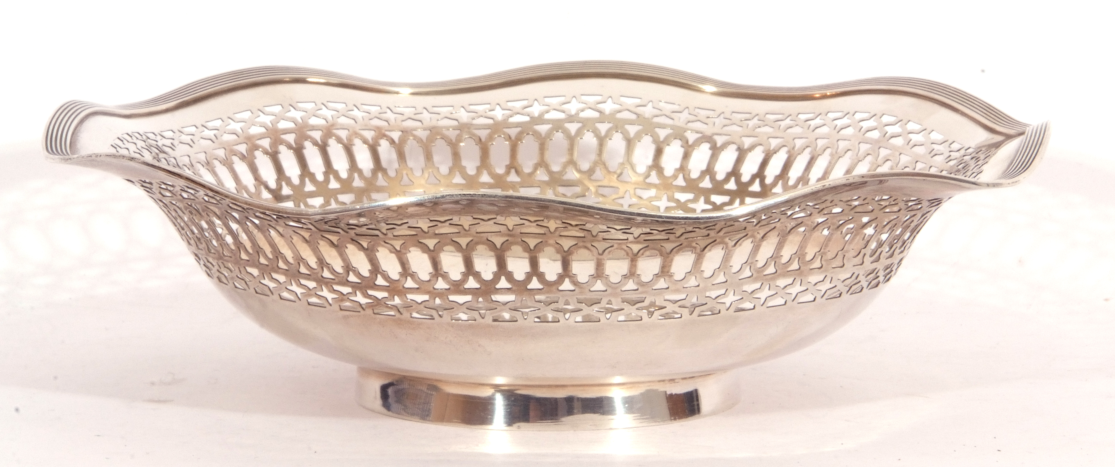 George V silver dish having pierced sides and reeded wavy rim and raised on a circular foot, - Image 2 of 4