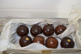 BOX CONTAINING SMALL WOODEN BOWLS