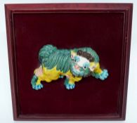 Chinese pottery mythical dragon on wooden mount decorated in various glazes, the dragon 13cm long