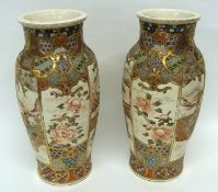 Large pair of Satsuma vases decorated in typical fashion with Japanese dignitaries within a