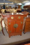 Modern Oriental style hardwood cabinet with carved decoration, width approx 81cm