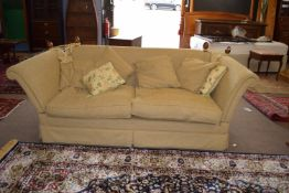 20th century Knole style two/three seater settee upholstered in beige fabric, having rope tied