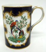 Porcelain tankard decorated in Worcester style with panels of exotic birds, pseudo crescent mark