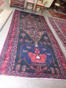 Vintage red ground Persian Tabreeze Carpet, bespoke medallion design surrounded by blue border 318cm