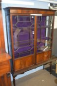 Edwardian mahogany display case or china cabinet, raised on tapered legs with astragal glazing,