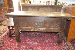 17th/18th century and later oak blanket box raised on stile legs with carved panel and planked