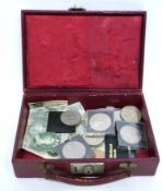 Small suitcase with quantity of paper money and old crowns