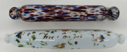 Two glass rolling pins, one with floral design with indistinct inscription, further pin with a