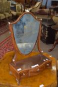 Edwardian shield-shaped toilet mirror raised on a serpentine three drawer base with ivory