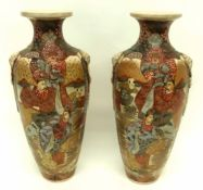 Pair of Japanese Satsuma vases decorated in typical fashion with Japanese figures, 40cm high (2)