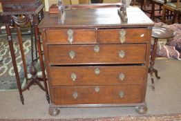18th century oak chest of two short over three long drawers, raised on bun feet with decorative