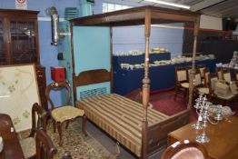 Early 20th century decoratively carved four poster single bed with turned supports, 101 x 203cm