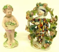 Derby model of a putto together with a small Derby model of a harlequin (damages) (2)