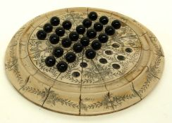 Solitaire board with scrimshaw type decoration, signed by John Adams, together with a quantity of
