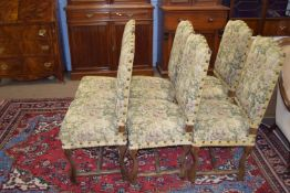 Set of six French style hardwood framed dining chairs, the backs and seats upholstered in floral
