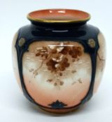 Hadley's Worcester small globular vase decorated with birds on branches
