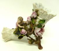 Continental porcelain flower vase modelled as a cornucopia, with roses in relief and a cherub