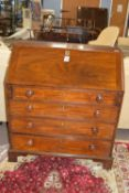Early 19th century mahogany drop front bureau raised on bracket feet, the fitted fall front interior