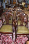 Set of eight (6+2) leather upholstered dining chairs with carved decoration