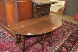 Low oval jointed oak gateleg table, approx 118 x 88cm