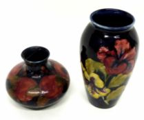 Moorcroft squat vase decorated with the pomegranate pattern (a/f), together with a further Moorcroft