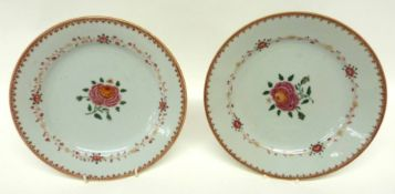 Two late 18th century Chinese export porcelain plates decorated in famille rose with floral designs,