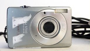 Canon Ixus 75 digital camera, together with charger and manual