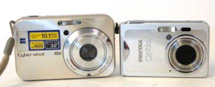 Pentax Optio S7 plus a Sony Cybershot DSC-N2 plus chargers