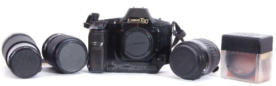 Canon T90 film camera with Vivitar 35-70mm lens and Vivitar 70-210mm lens and accessories.